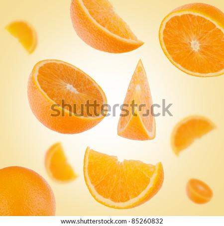 flying sliced orange fruit segments    background - stock photo