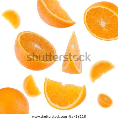 flying sliced orange fruit segments   isolated on white background - stock photo