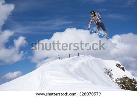Flying snowboarder on mountains, extreme sport