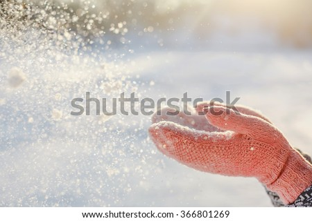 Flying Snowflakes. Blowing Snow in frosty winter Park on Sunny day. Joyful