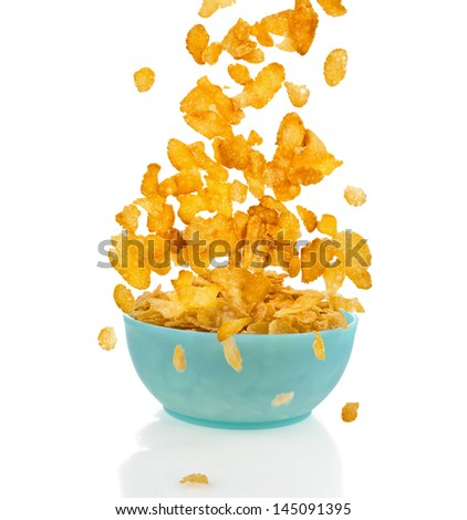 Flying to the bowl corn flakes isolated on white background - stock photo