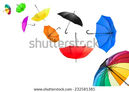 flying umbrellas in front of white background - stock photo