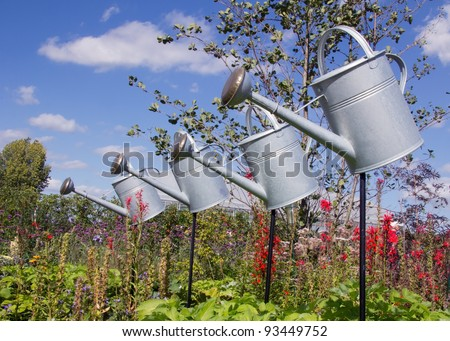 flying watering cans - stock photo