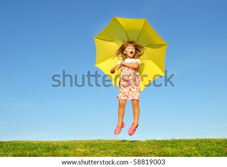 FLYING WITH UMBRELLA - stock photo