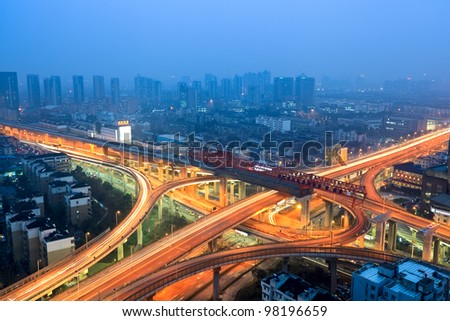 flyover in modern city at dusk - stock photo
