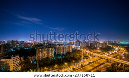 flyover of Chengdu in the evening - stock photo