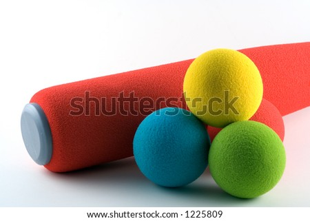 Foam bat and soft balls - stock photo