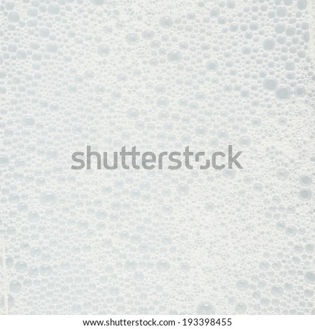 Foam bubbly soap water fragment as a background texture - stock photo