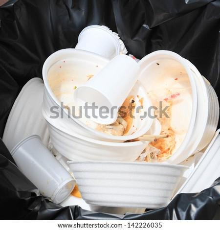 Foam food container trash bag - stock photo