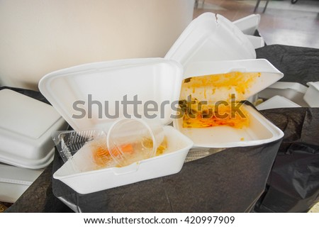 Foam food containers in the bin - Takeaway food and environmental problems concept  - stock photo