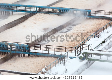 Foam in aeration tanks of sewerage treatment plant - stock photo