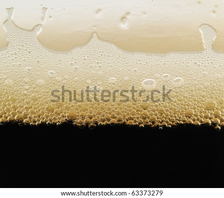 foam of dark beer with bubbles - stock photo