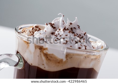 foam of whipped cream and chocolate chips close-up Viennese coffee glass top
