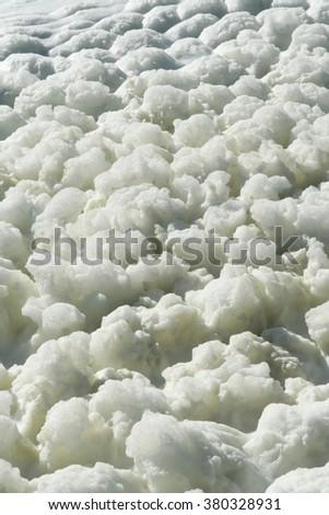 Foam on the lake water. Lake water foam. - stock photo