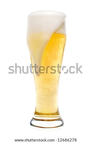 Foaming beer in a pilsner glass - stock photo
