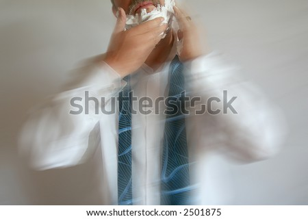 Foaming Businessman running late for work with Motion Blur - stock photo