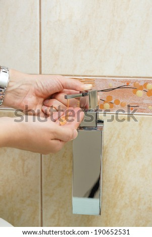 Foaming hand soap for washing hands - stock photo