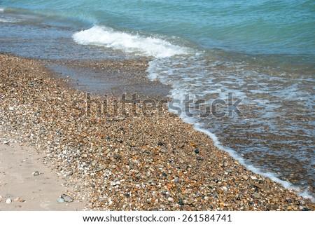 Foaming waves on the Lake Michigan shore, Indiana Dunes, USA - stock photo