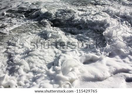 Foamy seething wave - stock photo