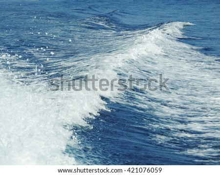 Foamy wake behind the stern of the ship