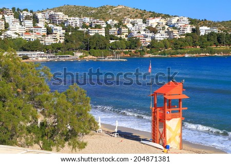 Foamy waves on the shores of the Aegean sea, Vouliagmeni, Greece - stock photo