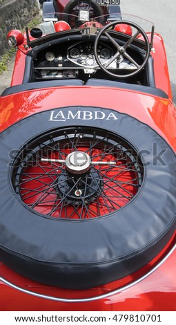 FOBELLO, ITALY - SEPTEMBER 3, 2016: Detail of a classic car, Lancia Lambda model, that was produced from 1923 to 1931.