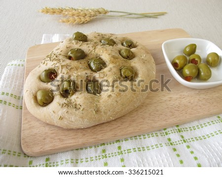 Focaccia bread with rosemary and olives - stock photo