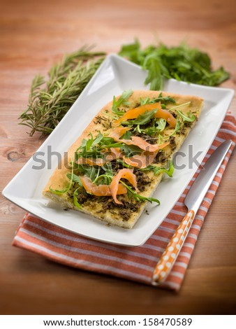 focaccia with smoked salmon arugula and rosemary, selective focus