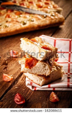 Focaccia with tomato and green olives. Retouching in retro style