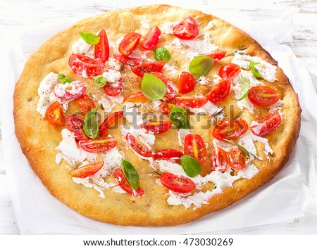 Focaccia with tomatoes, cream cheese and basil.