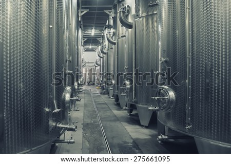 Focsani, Romania - October 16: Stainless steel fermenters used to make wine inside winery Garboiu, on 16 October, 2014, Focsani, Romania - stock photo
