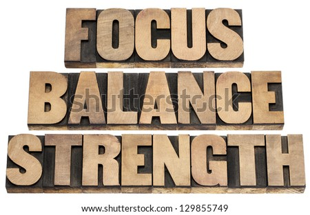 focus, balance, strength  - performance concept - isolated text in letterpress wood type printing blocks