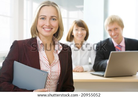 Focus is on the businesswoman in front - stock photo