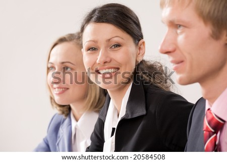Focus is on the woman in the middle - stock photo