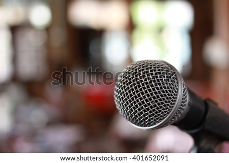 focus microphone is on the duty, action microphone on the stage, single microphone with blur background - stock photo