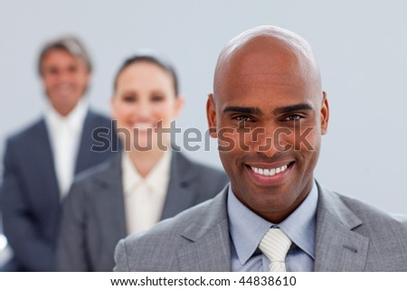 Focus on a confident ethnic businessman smiling at the camera