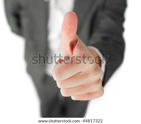 Focus on a thumb up isolated on a white background