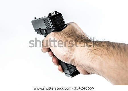 focus on back aim gun sight of black color gun holding in hand isolated on white background - stock photo