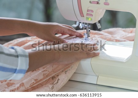 Focus on beautiful ladies hand sewing lace.