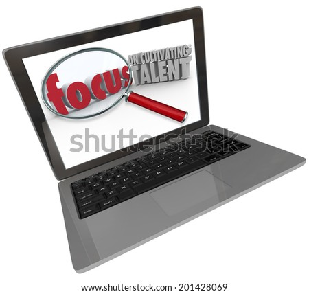 Focus on Cultivating Talent words under a magnifying glass on a computer laptop screen