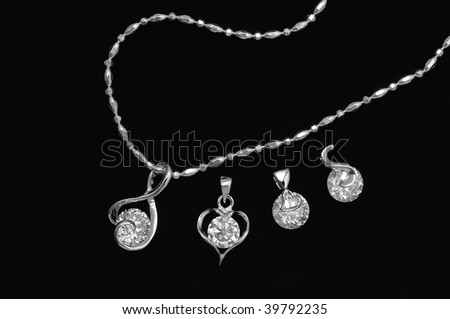 focus on diamond pendant with black background - stock photo