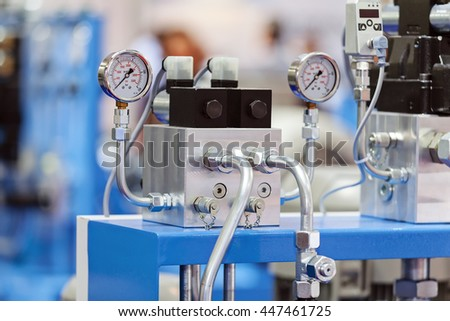 Focus on measuring apparatus device of engine for industry; note shallow depth of field