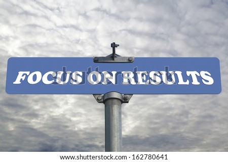 Focus on results road sign - stock photo