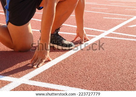 Focus on runner start points, at which point release. - stock photo
