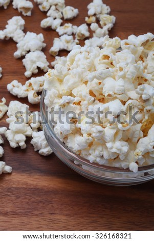 focus on salty popcorn in a  transparent bowl ready to serve