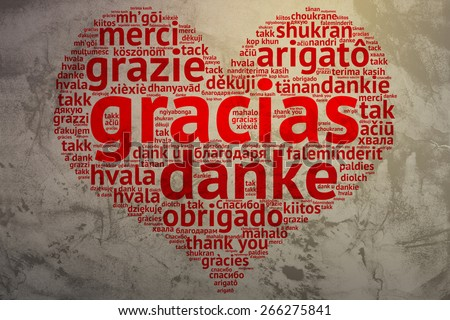 Focus on Spanish: Gracias. Word cloud in heart shape on Grunge Background. saying thanks in multiple languages. - stock photo