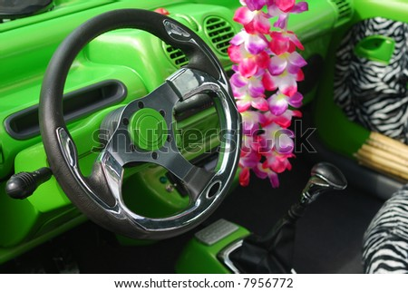 Focus on steering wheeel of an interior relooked car - stock photo