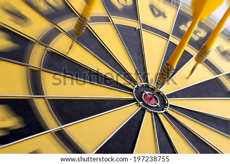 Focus on target center of dartboard with zoom filter. - stock photo