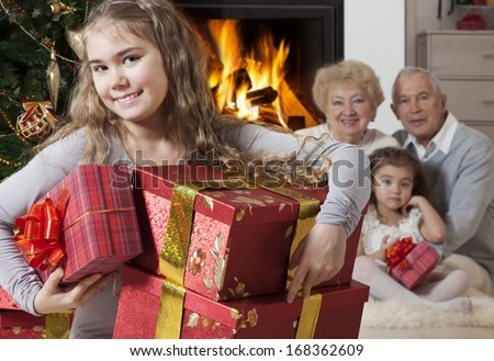 Focus on the happy little girl with Christmas presents   - stock photo