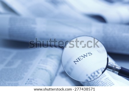 focus on the news, blue tinted  - stock photo